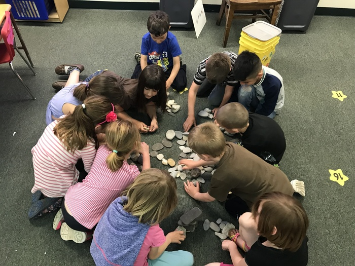 students playing with rocks