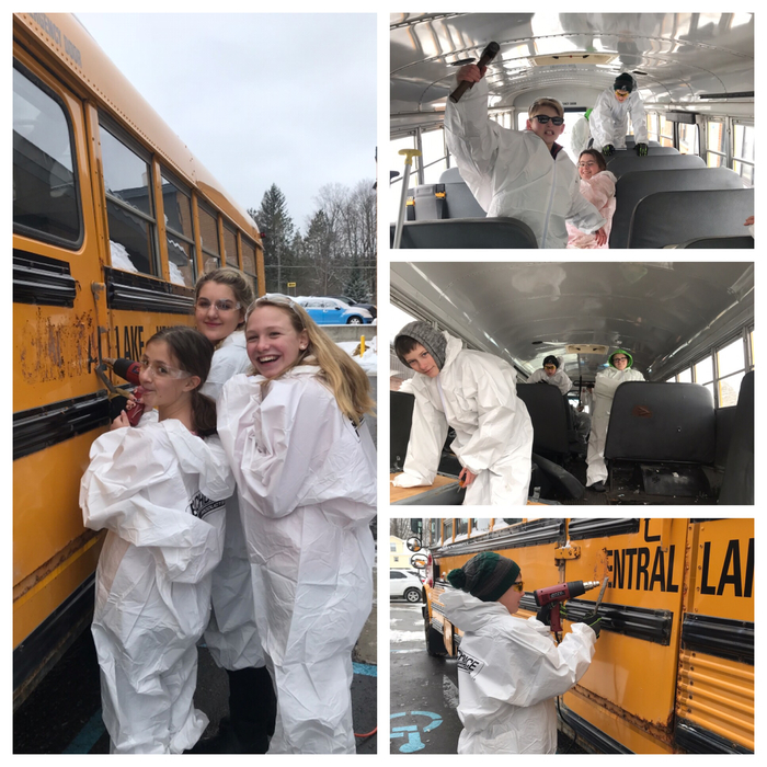 Students working on bus